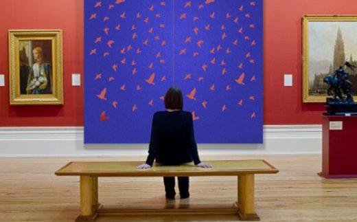 Laser Felt Eco, Flying Birds, Cobalt color wall panels in the art gallery.