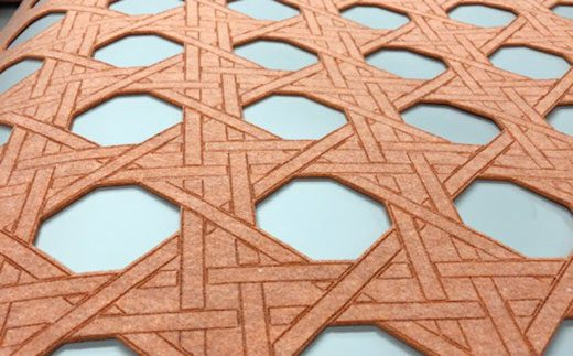 Laser cut and engraved custom design on felt wall covering